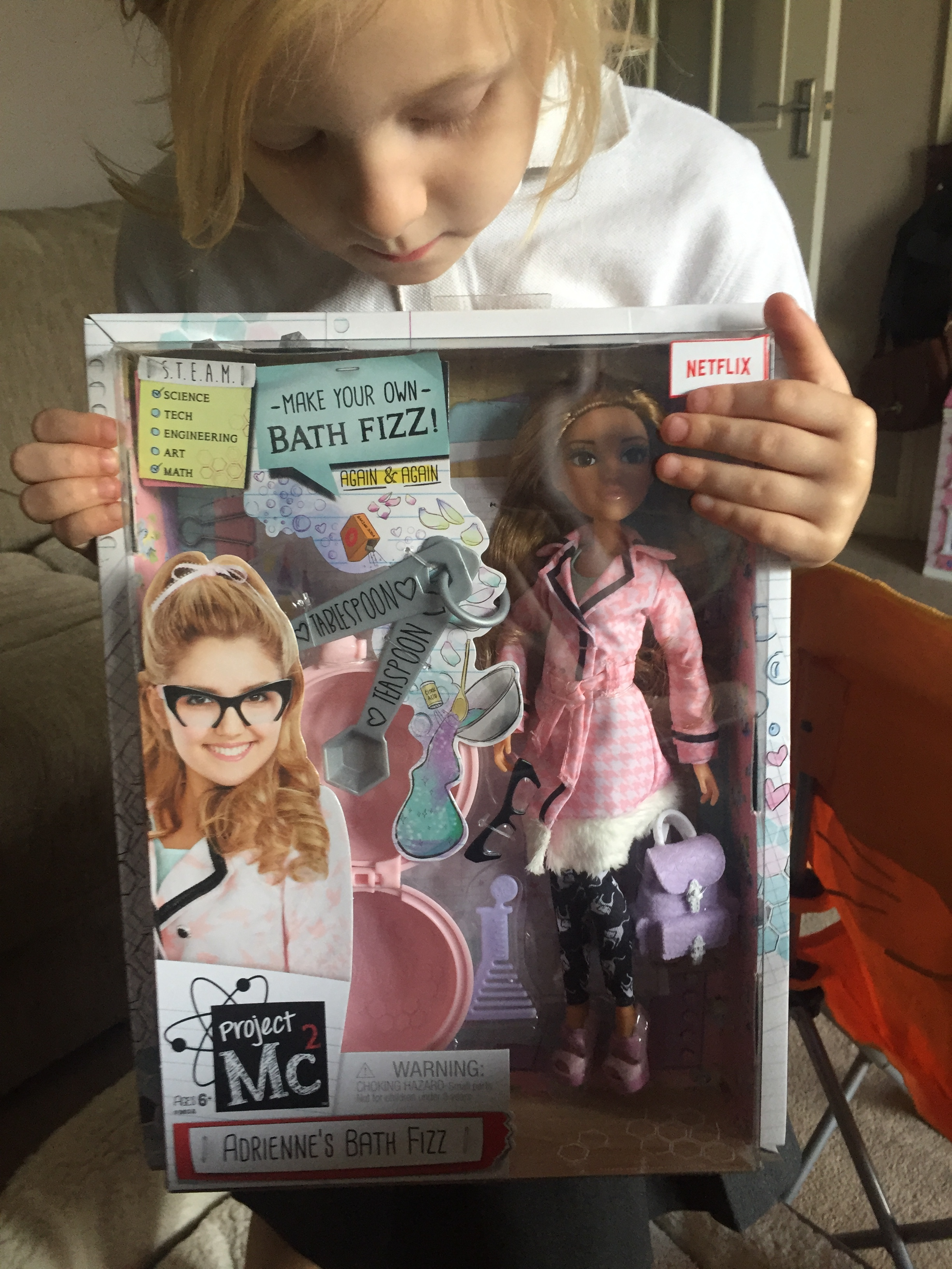 Adrienne Attoms is part of the Project Mc2 collection of dolls that involve the S.T.E.A.M. approach to education. (Science. Technology. Engineering. Arts. Math). They are designed to encourage and stimulate interest in science and math.
