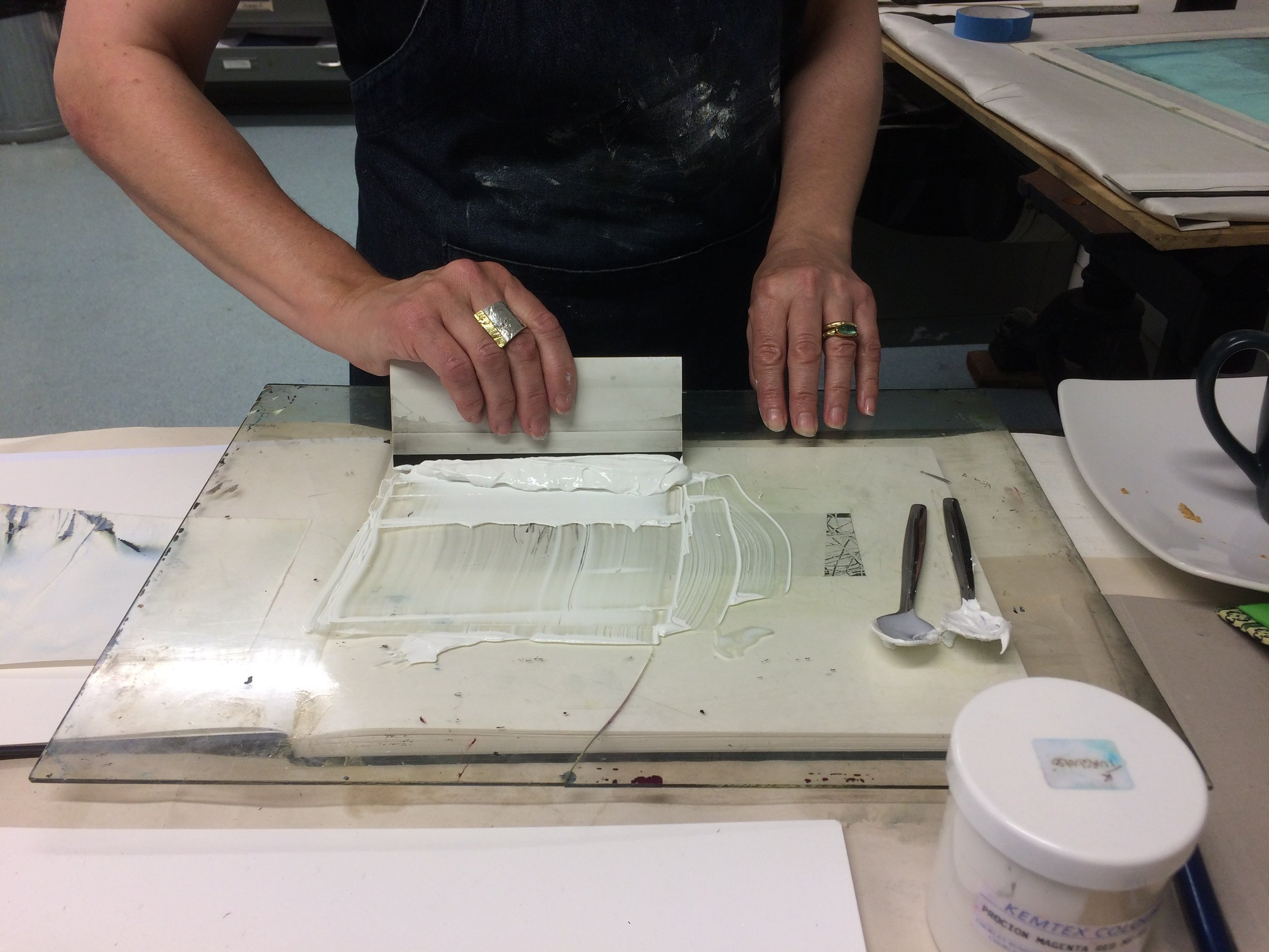 Helen Terry working on some of her screen prints at Digswell Arts print room July 2017