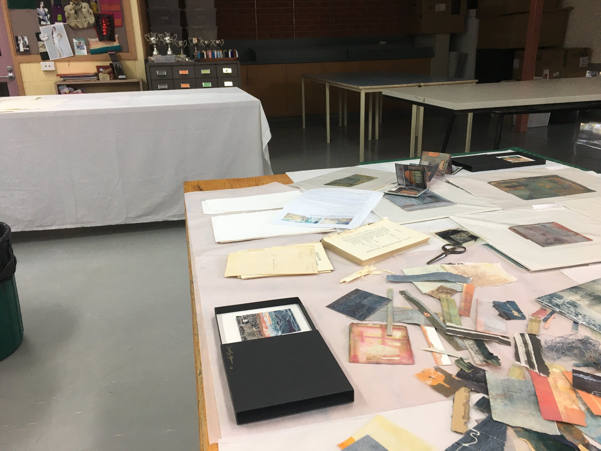 Classroom at Ballarat, with paper, tools and example work plus work for sale. July 2018