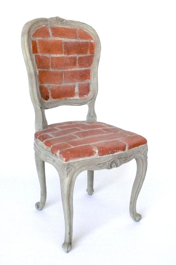 """Brick Chair"" (2008)<br>Brick, mortar, wood, flocking, adhesive, straw.<br>38 x 17 x 18 in."