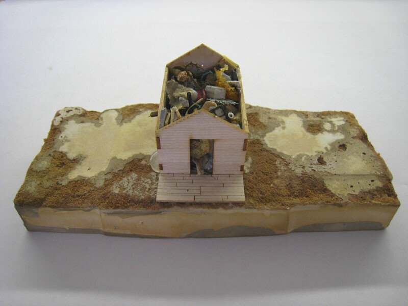 "Jeremy Mora  ""Relic"" (2008) Wood, cement, various media, 7 x 5.5 x 5.5 in."