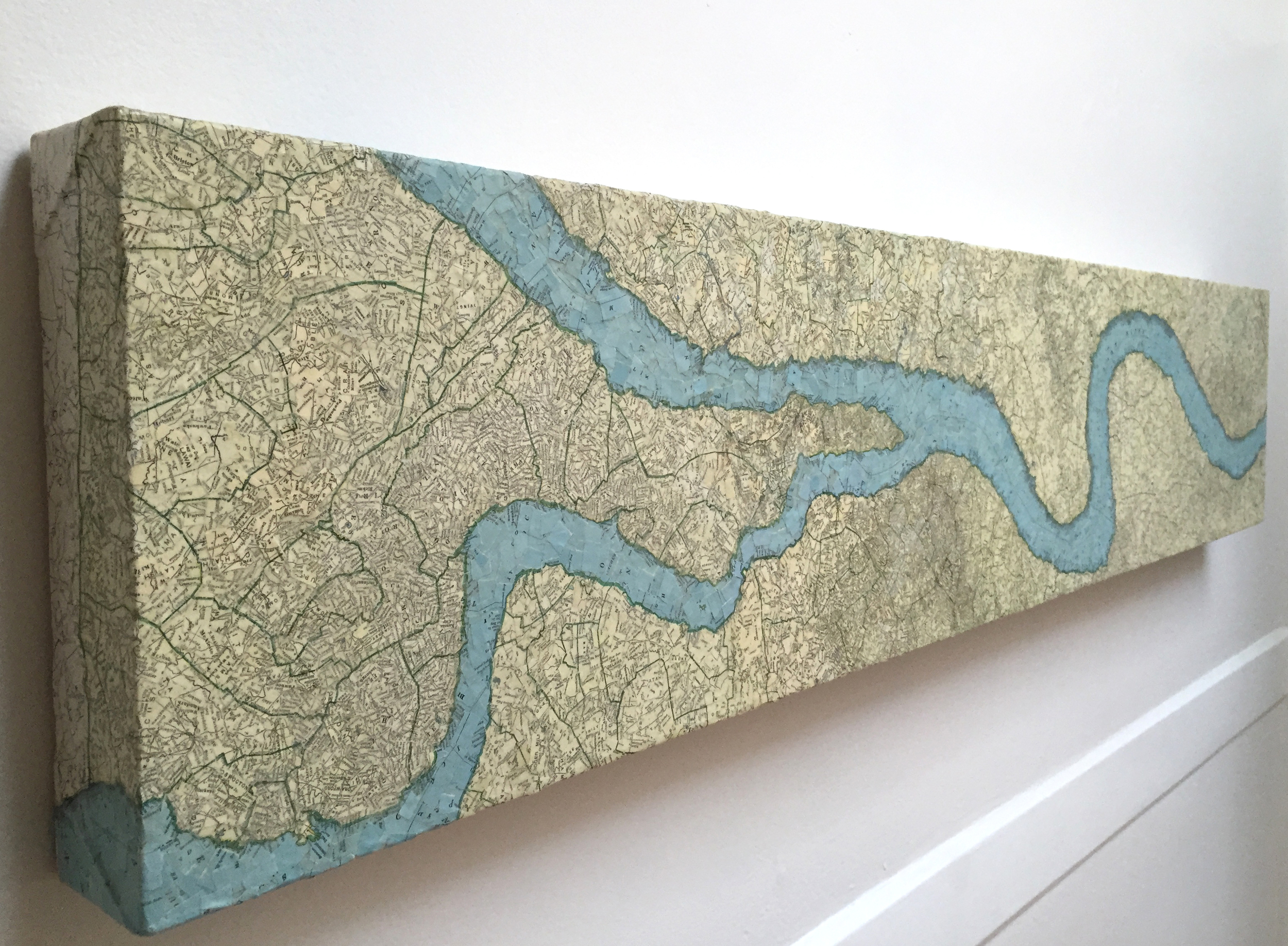 """Lazy River"" (2009)<br>Torn map collage on canvas, 12 x 48 x 3 in."