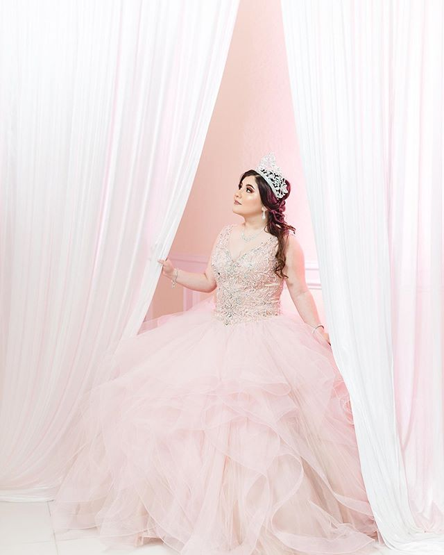 Love this simplistic shot of Our Bella Quinceanera.⁣ ⁣⁣ #thathighlighttho ⁣⁣⁣ ⁣ 📸 Behind The Shot Tip : When I saw the white drapes in the venue, I knew I wanted to throw a pink gel on my light and light it up. One light placed camera right, behind the subject/curtain. One light on Glow Parapop softbox in front of curtain, camera left.⁣⁣⁣⁣ Shot on My @nikonusa with @adorama Flashpoint AD200s . . *Reminder Weddings moves to @inezlaraweddings
