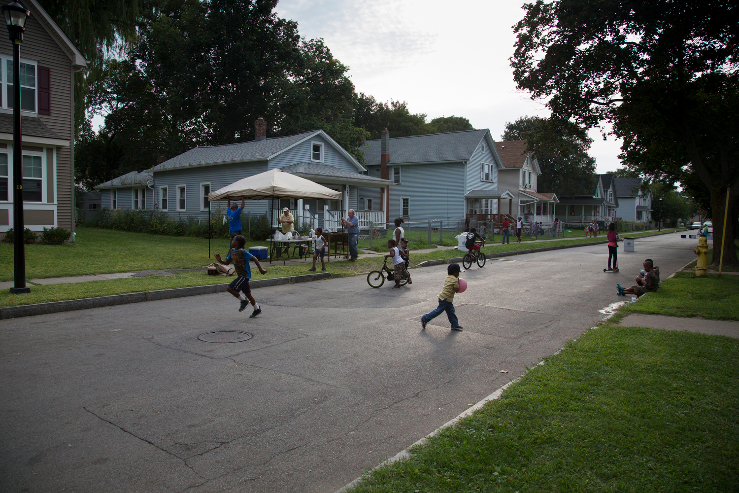 The Marketview Heights Collective Action Project Block Party winds down for the evening on Weld Street, Rochester, N.Y., Aug. 29, 2015. This is the third annual block party for the community after about a 30 year hiatus.