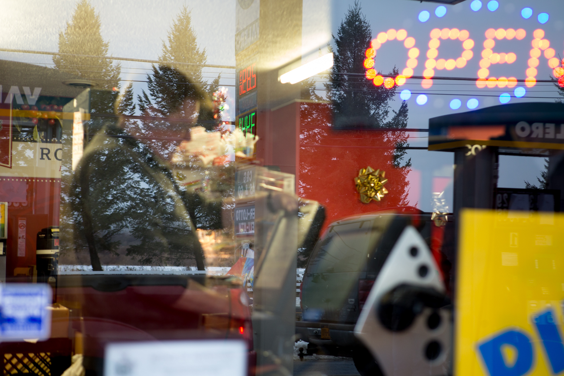 Clair Milburn, 71, mans the cash register after his shift change with his brother, Gary Milburn, at the C&G Gas & Go, Leroy, N.Y., Dec. 14, 2014. Clair and Gary each work 6 days a week at the shop they opened in May 2014.