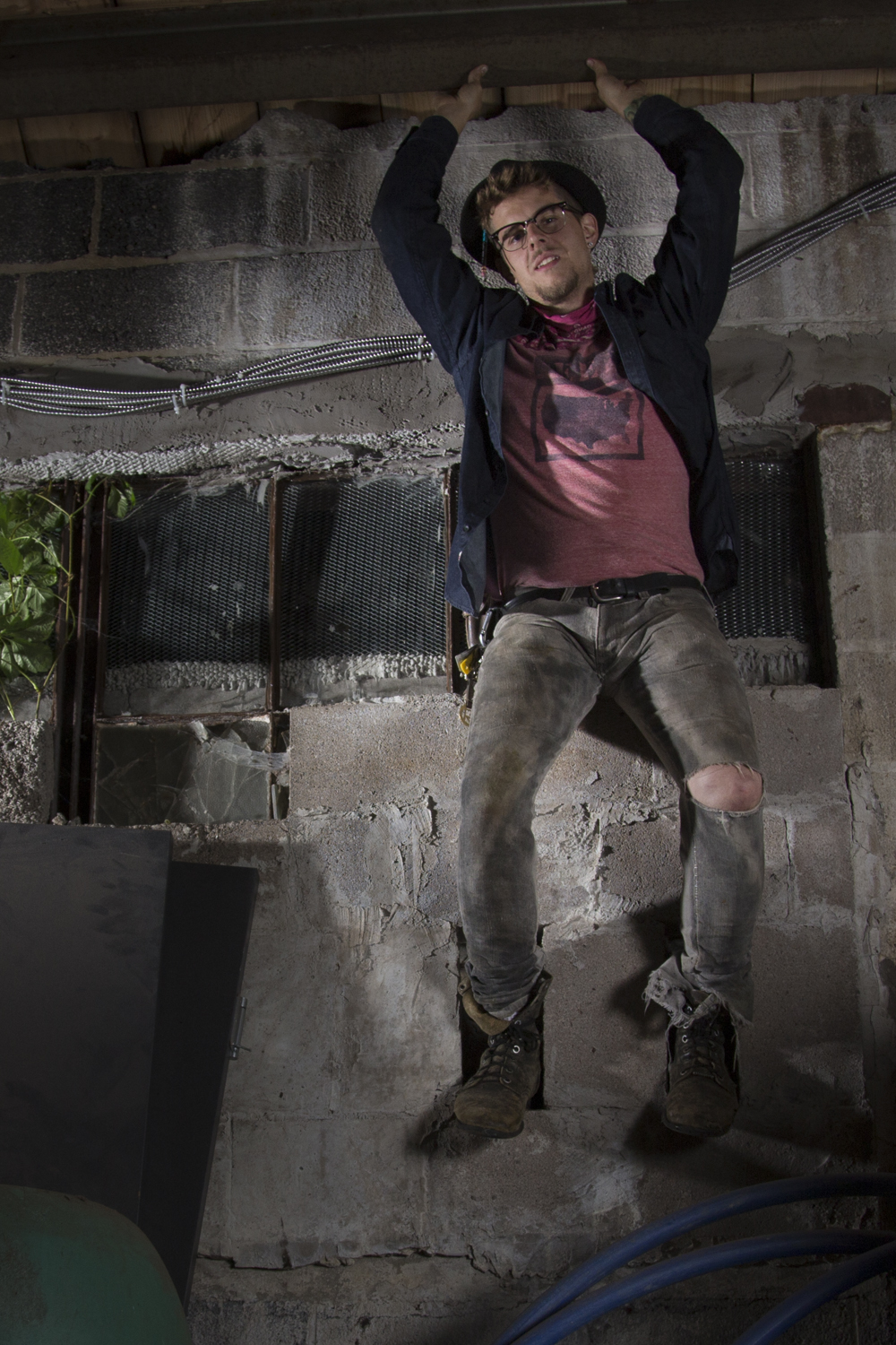 Josiah Krause, Seedfolk City Farm, poses for a portrait in an old warehouse, Rochester, N.Y.
