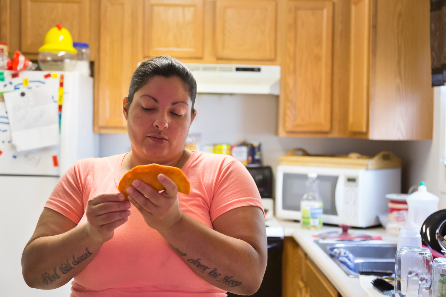 Jocelyn Kirkland makes pastellilos in her kitchen in the Marketview Heights Community, Rochester, N.Y., August 1, 2015. As they are made the family and friends come in and help themselves to this treat.