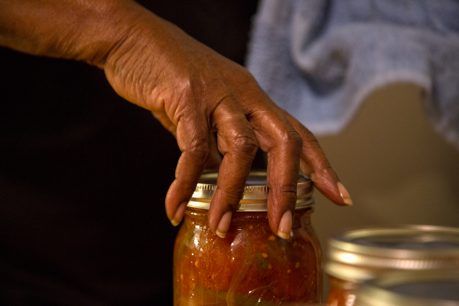 "The Marketview Heights Collective Action Project member, Bertha Jones cans tomatoes in her home in Rochester, N.Y., Aug. 25, 2015. ""This is how we do things."""