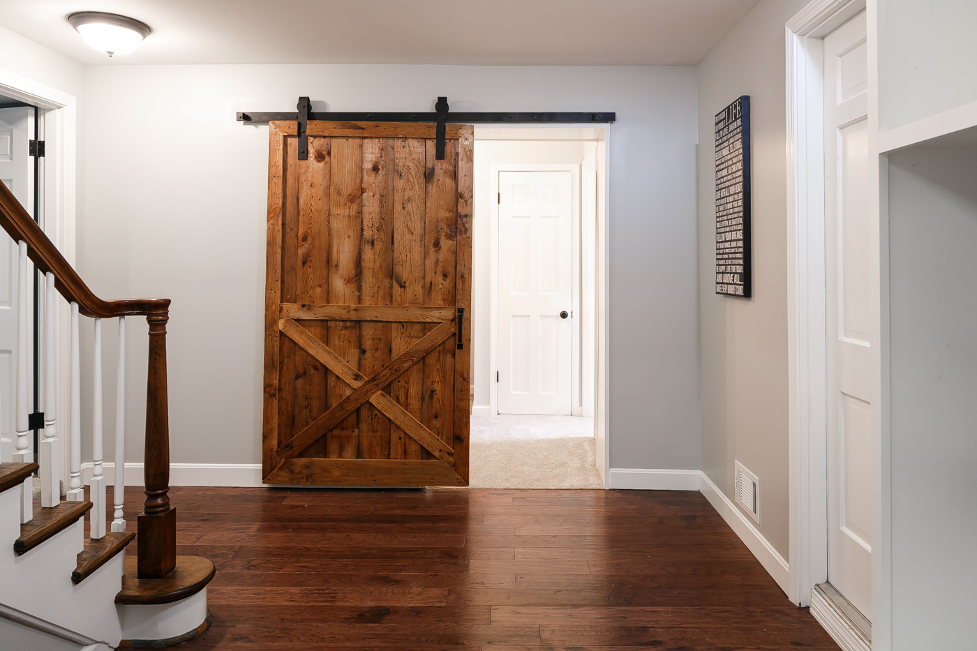Sliding barn door to office and full bath