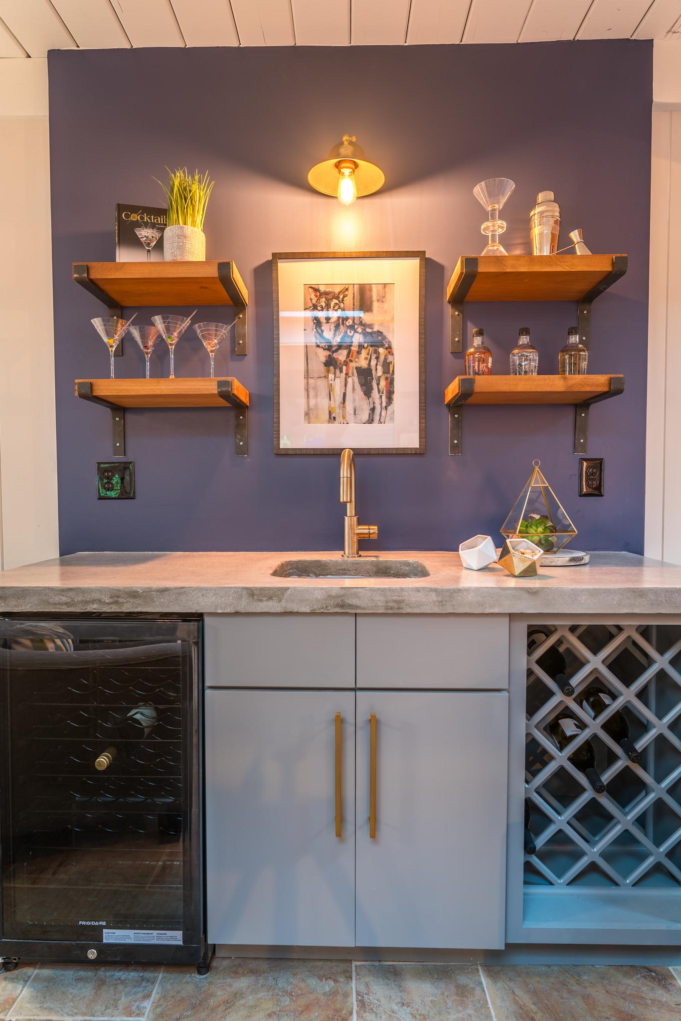 Custom wet bar with beverage fridge and wine rack