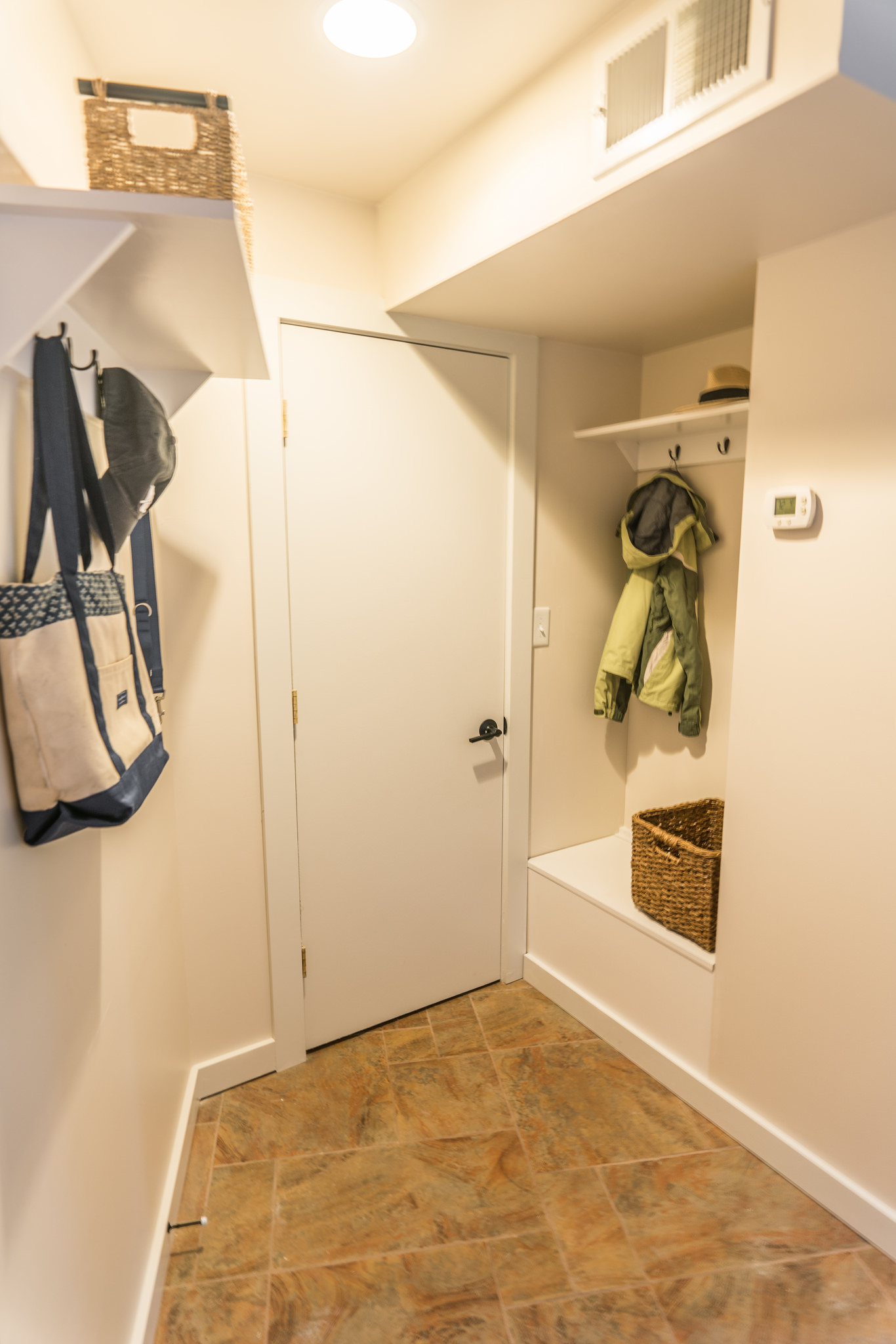 Cubby/storage area off side entrance
