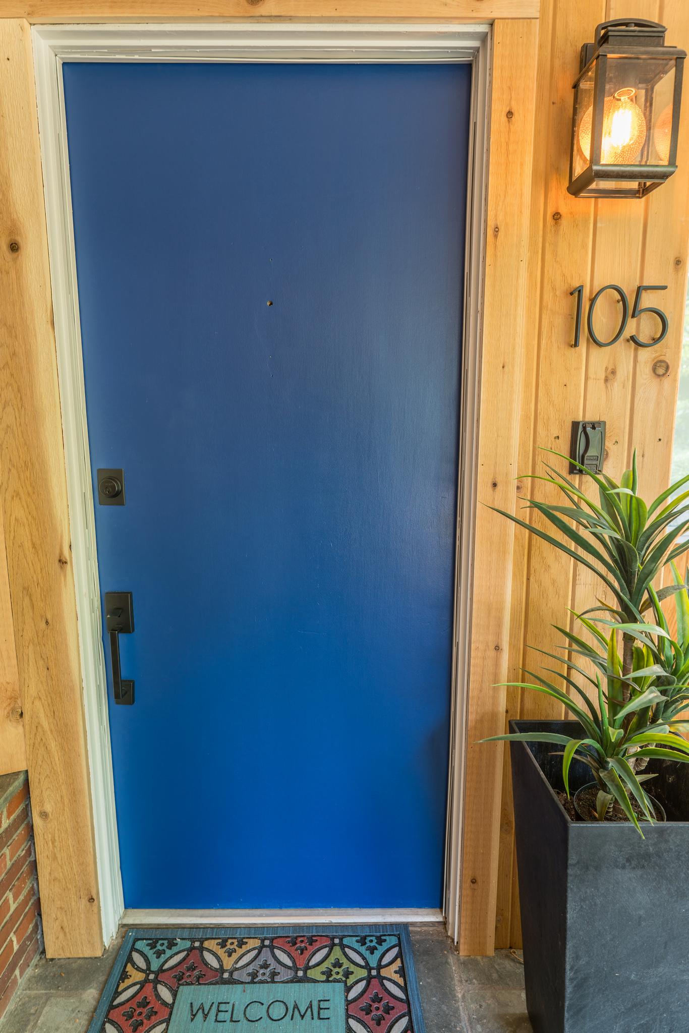 Cedar siding and blue doors
