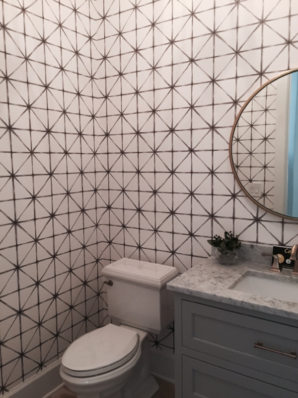 Powder room in house #1, the Maverick's Landing, by  Caliber Homes