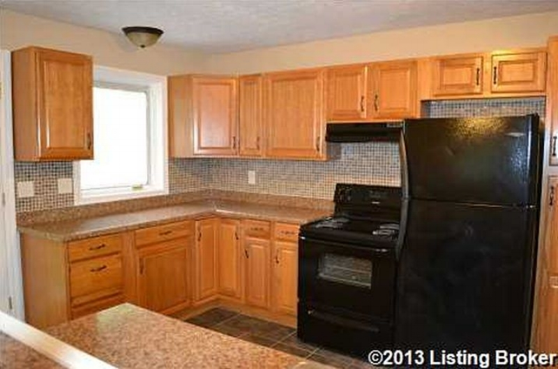 A brand new kitchen with a tile backsplash in a sub- $110k house? Yes please!