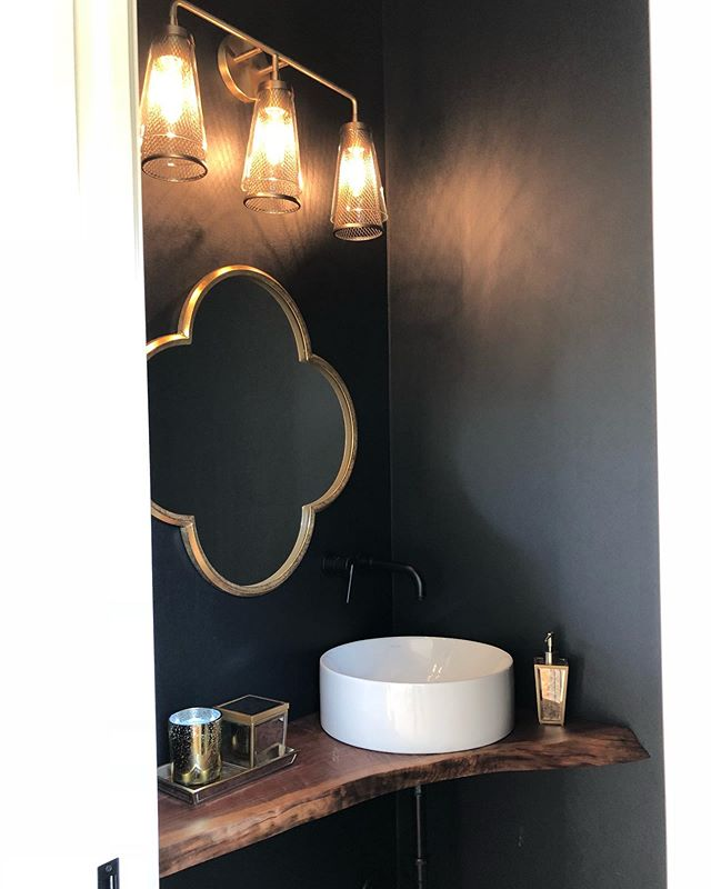 "More from @homearamalouisville... Loved this powder room off of a mudroom/garage entry. Proof that you can fit a sink in a narrow space with a little creativity- also LOVE the live edge custom ""vanity"" - I personally wouldn't do this in a full bath, but in a powder room I love more unique, rustic ""sink shelves""! ➡️ Also - hard to tell from this picture, but the wall covering was a textured black ""leathered"" vinyl??? material. Subtle, but made a big statement in a small space! ❤️ also love the black, champagne bronze, and natural wood color combo.  #bathroom #bathroomdesign #powderroom #bathroomremodel #reclaimedwood . . . #house #home #remodel #renovation #restoration #realestate #homedecor #interiordesign #flippinghouses #houseflipping #realestateinvestor #diy #homeimprovement #homedecor #interiordesign #mydomaine #sodomino #apartmenttherapy #louisville #kentucky #girlboss #hgtv #diynetwork"