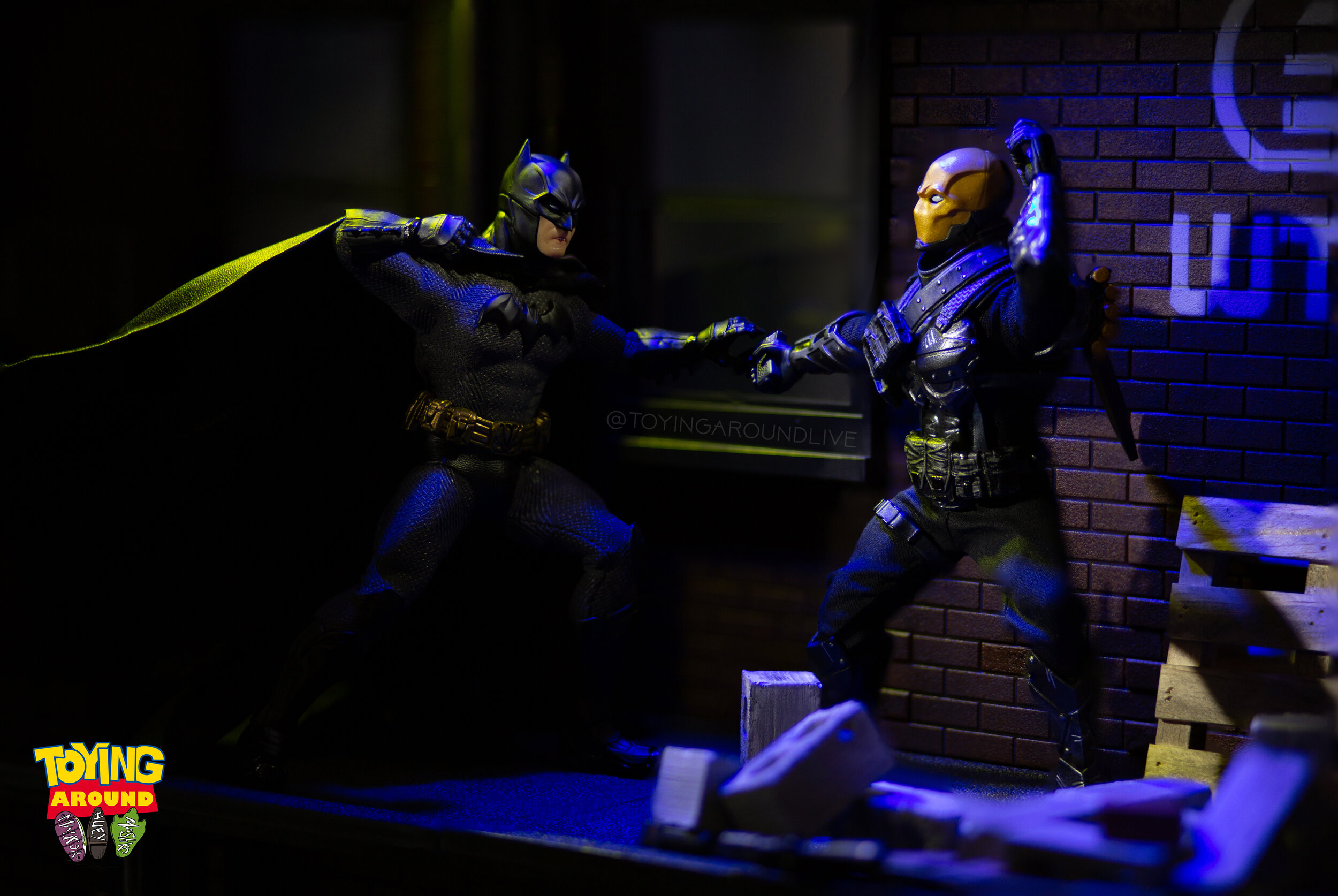 Batman Disarms Deadshot.jpg