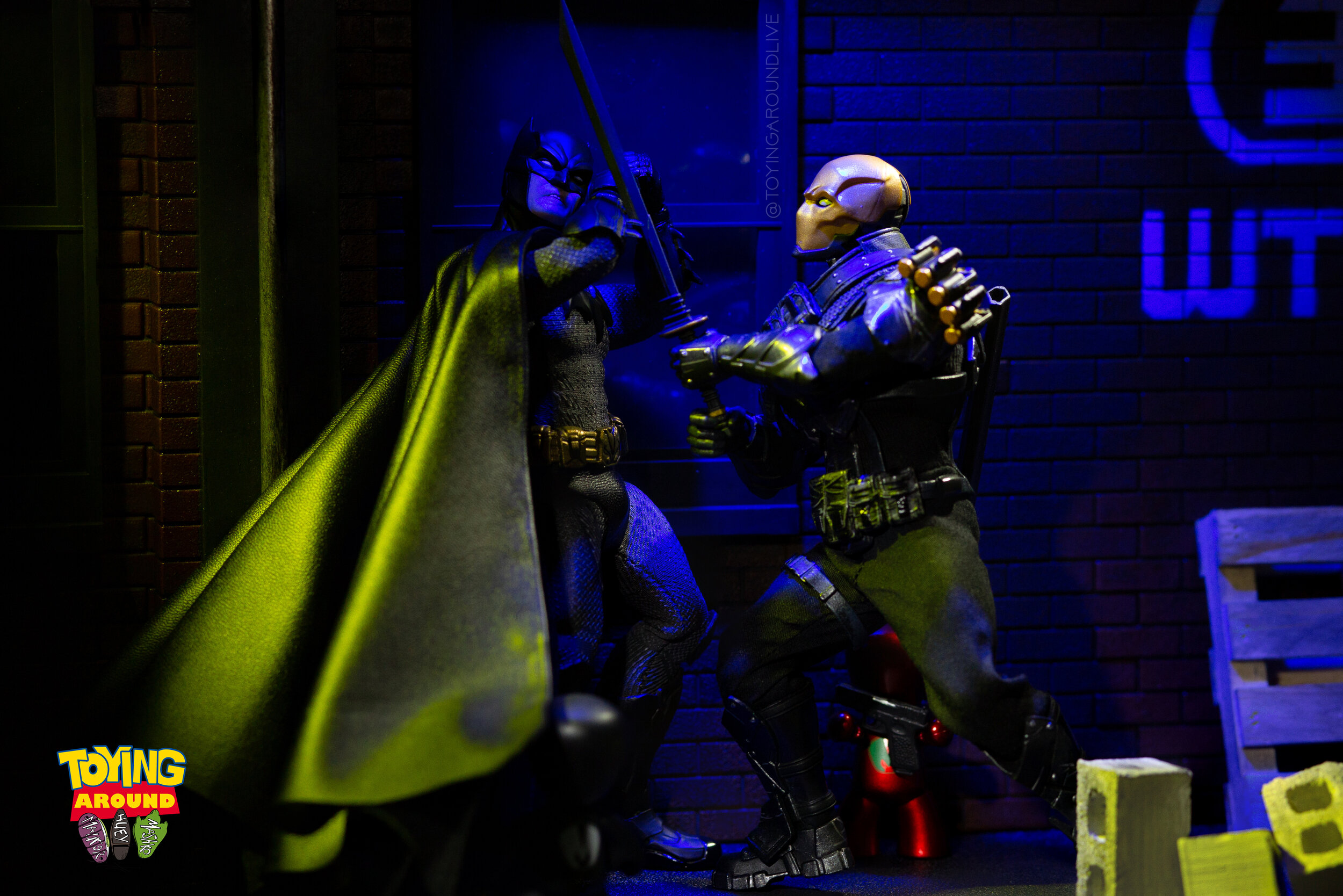 Batman Defends Against Deadshot Sword.jpg
