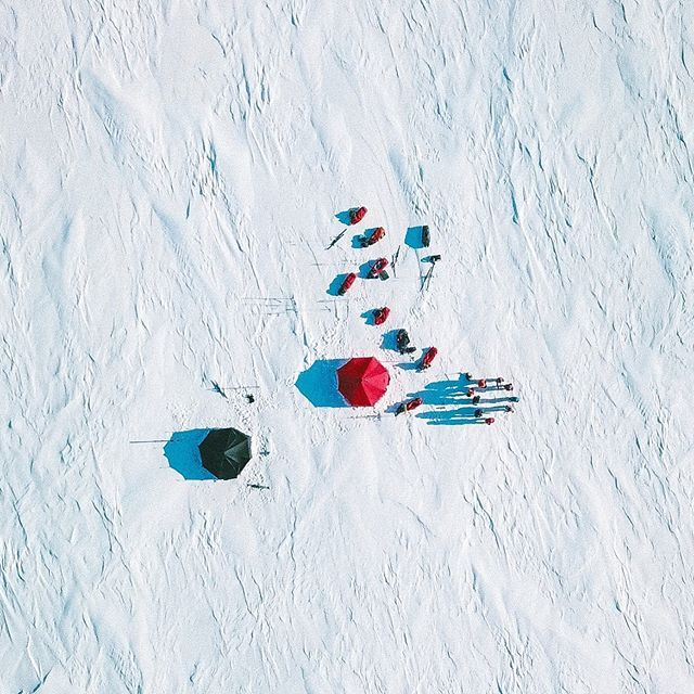 Tents out on the open ice are extremely exposed so we often had to build wind walls out of cut snow blocks. The wind died down long enough to put the drone up to get some beautiful aerial shots #setlife #videoproduction #filmmaking