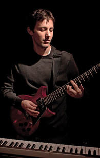 Ariel Kasler, guitarist/pianist