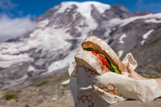 You will definitely have the best lunch while sitting with the masses at Panorama Point,  Mt. Rainier National Park  (insider tip, pass up the official viewpoint and keep going to the height of the High Skyline Trail. The views are even better and it is sometimes a little less crowded).