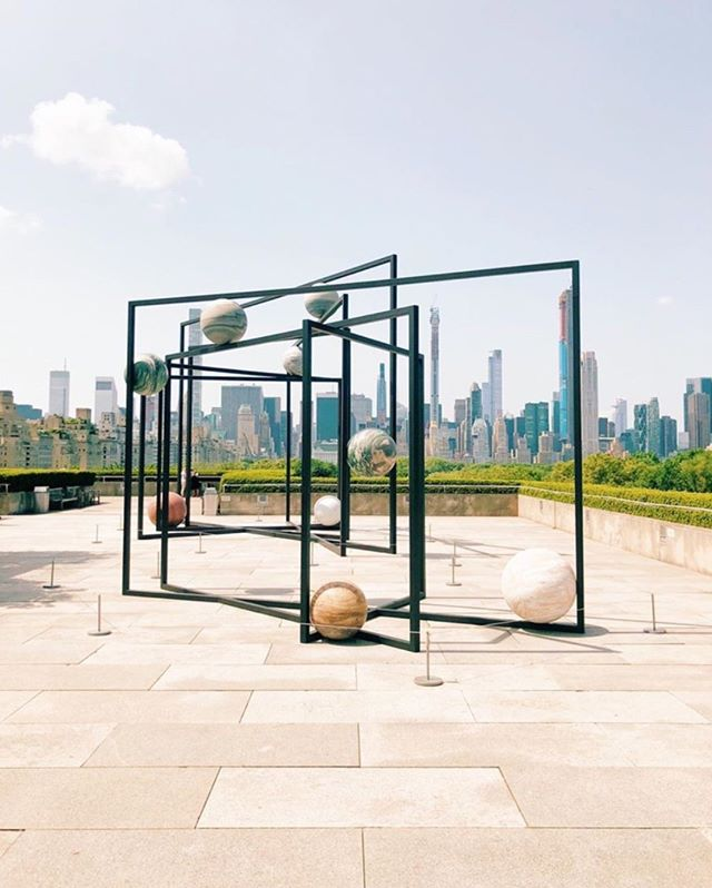 """Every summer at the @metmuseum, a new art installation is on display on its rooftop.  This year's piece is """"Parapivot"""" a mini solar system made of stell and stone by artist @alicjakwade . . . #thompsonhousegroup #thompsonsquarestudios #soho #sohonyc #coworkingspace #coworkingnyc #elevated #workspace #happyhournyc #eventplanning #luxuryeventspace #community #officegoals #elevated #luxury #luxurylifestyle #luxuryevents #private #membersclub #membersonly #prettycitynewyork #seeyourcity #nycgo #timeoutnewyork #sohonyc"""
