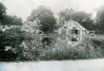 This image, contributed to The Tweed News by Mrs. Lorraine Shea of Tweed, shows Lost Channel as it appeared in the 1940s. The sawmill is the building to the right. The centre building housed the waterwheel. Broom handles and cheese boxes for the area's many cheese factories were produced in the building to the left. This once busy industrial site also contained a gristmill and a veneer-making building, both of which lay outside the reach of this photograph.