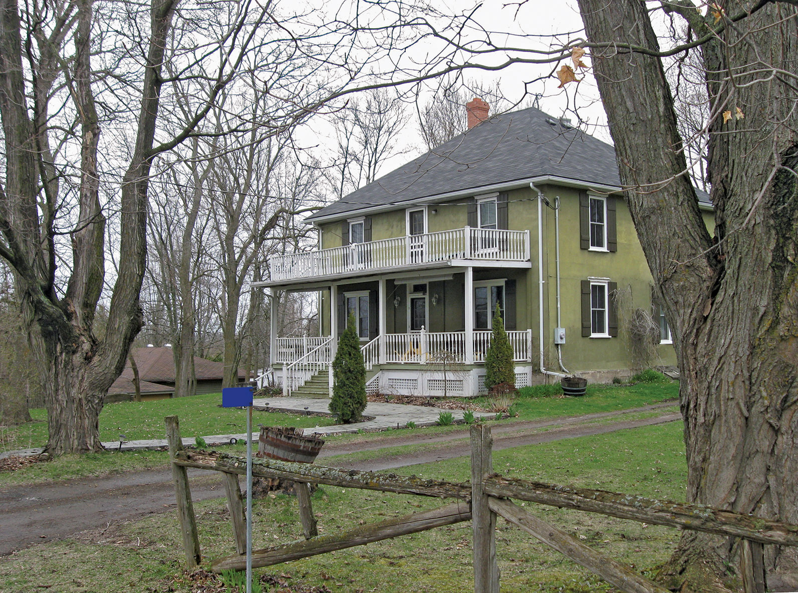 The dignified Bonter family farmhouse still stands above Crowe Lake.