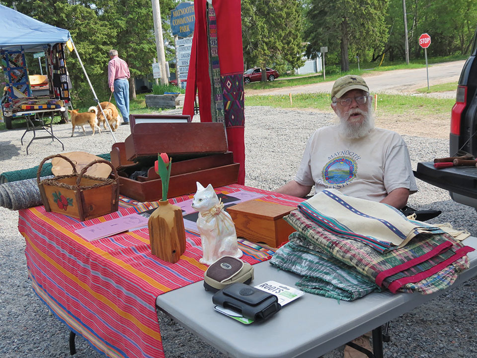 Poet Peter Jones is a market regular signing copies of his books and sharing selections with patrons.