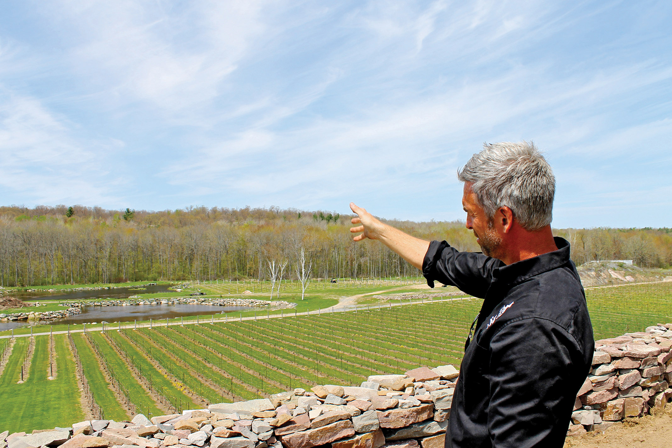 Big dreams just get bigger: Johnson describes future plans for Hasting's first winery, including more construction, landscaping, and hosting weddings and special events.  Photo by Michelle Annette Tremblay