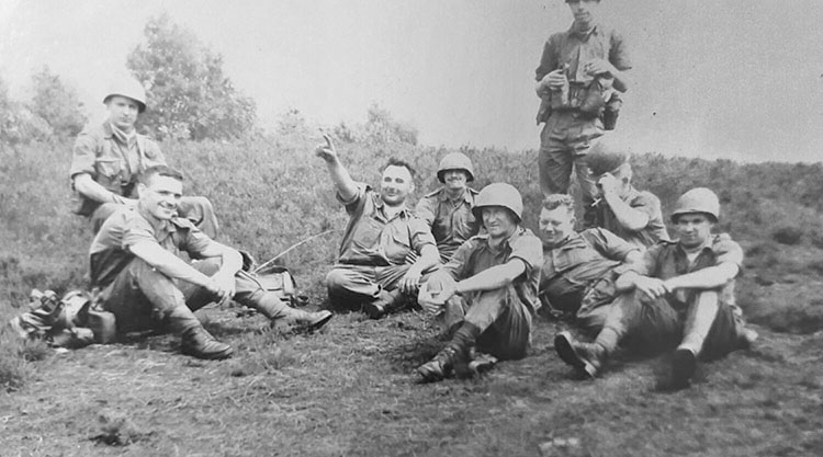 Earl Pearson (pointing), shown on maneuvers. His military career started with the Hastings Prince Edward Regiment, and he was later transferred to the 1st Canadian Guards and then the Royal Canadian Regiment. Photo courtesy the Pearson Family