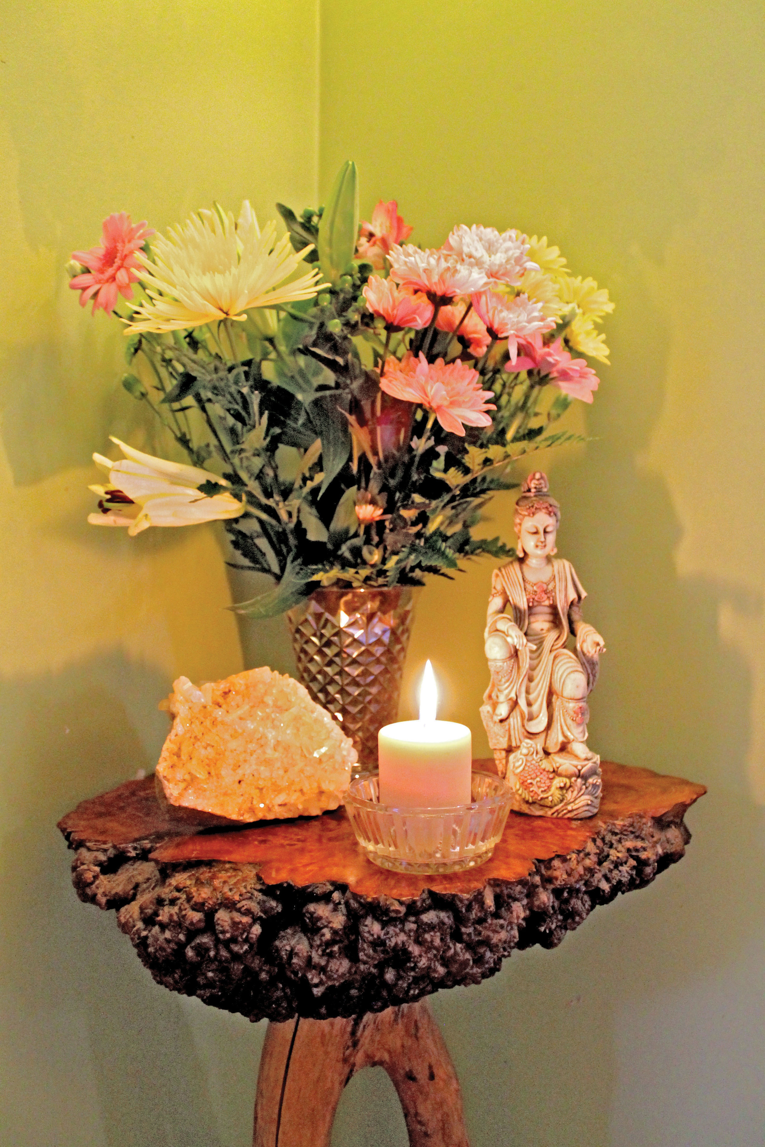 Small shrines to the Hindu Deities with crystals and flowers dot Springer's North Hastings studio. Photo by Michelle Annette Tremblay