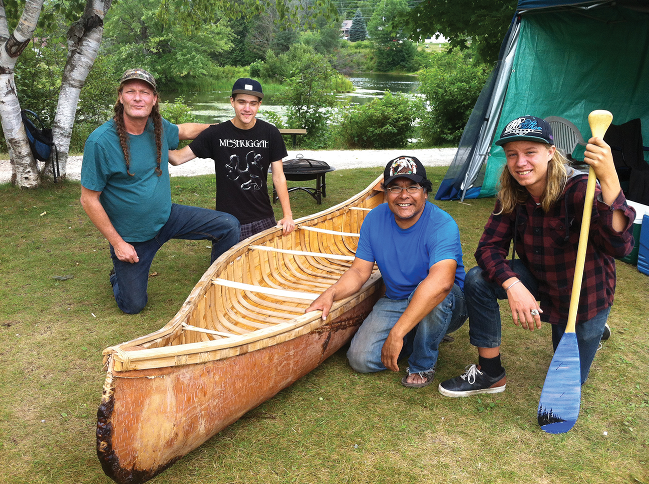 Stephen Hunter in Bancroft, at Millennium Park, prepares to test canoe built in 2016, as part of a cultural tourism project in partnership with the Town of Bancroft.