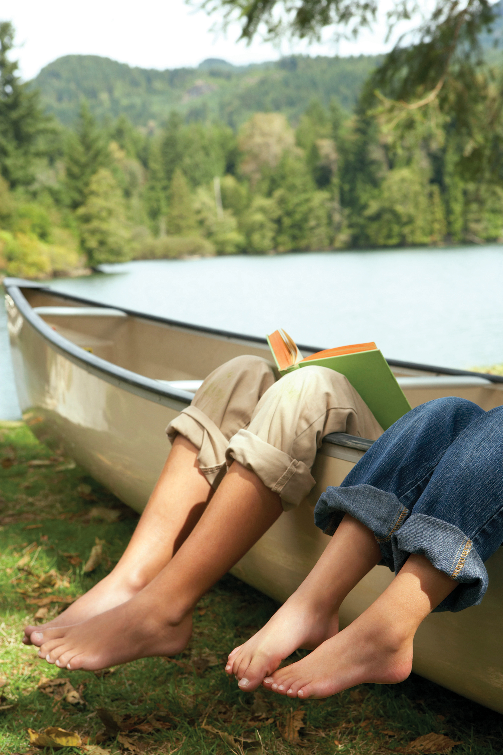 A canoe portage isn't all work and no play for these two friends as they take time to relax with their books. Photo courtesy Eastern Ontario Trails Alliance.
