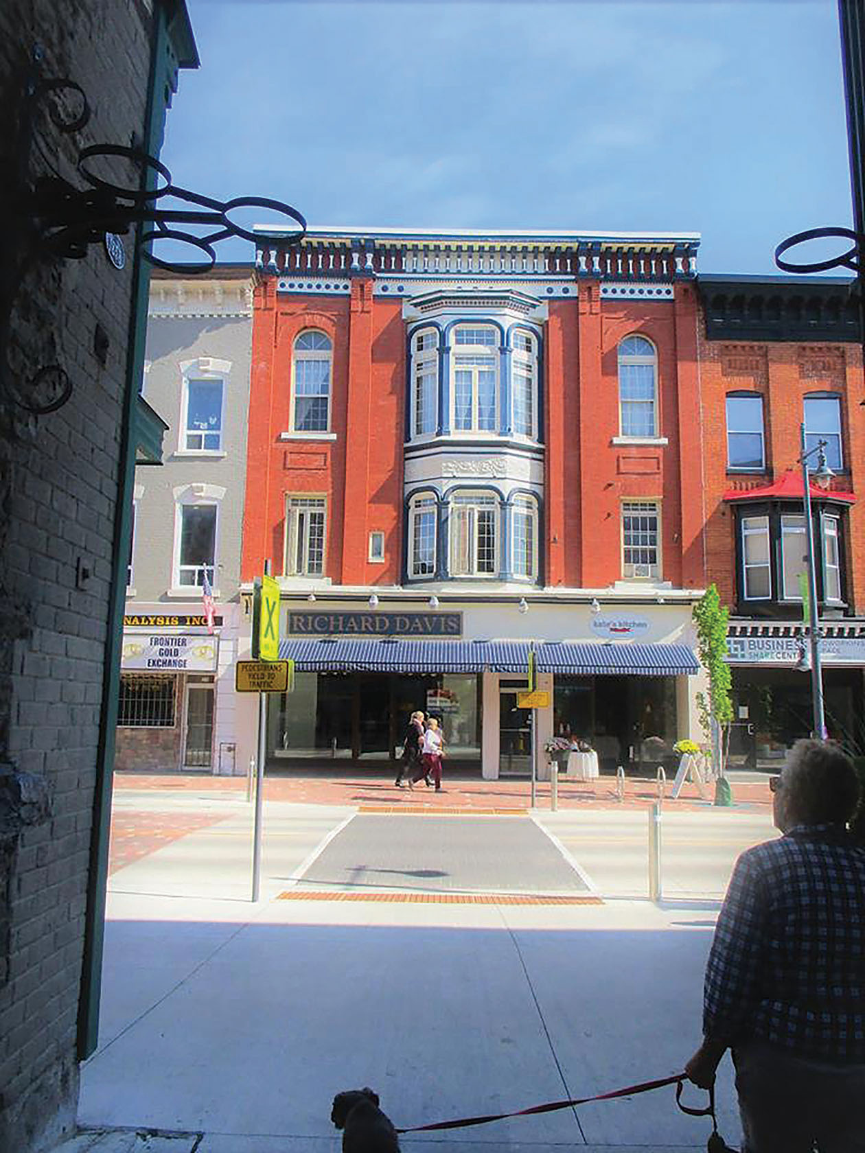 Pedestrians strolling along the Belleville Footbridge walk out to an example of a beautiful historical renovation that combines modern retail spaces with residential units. Photo by Shelley Wildgen.
