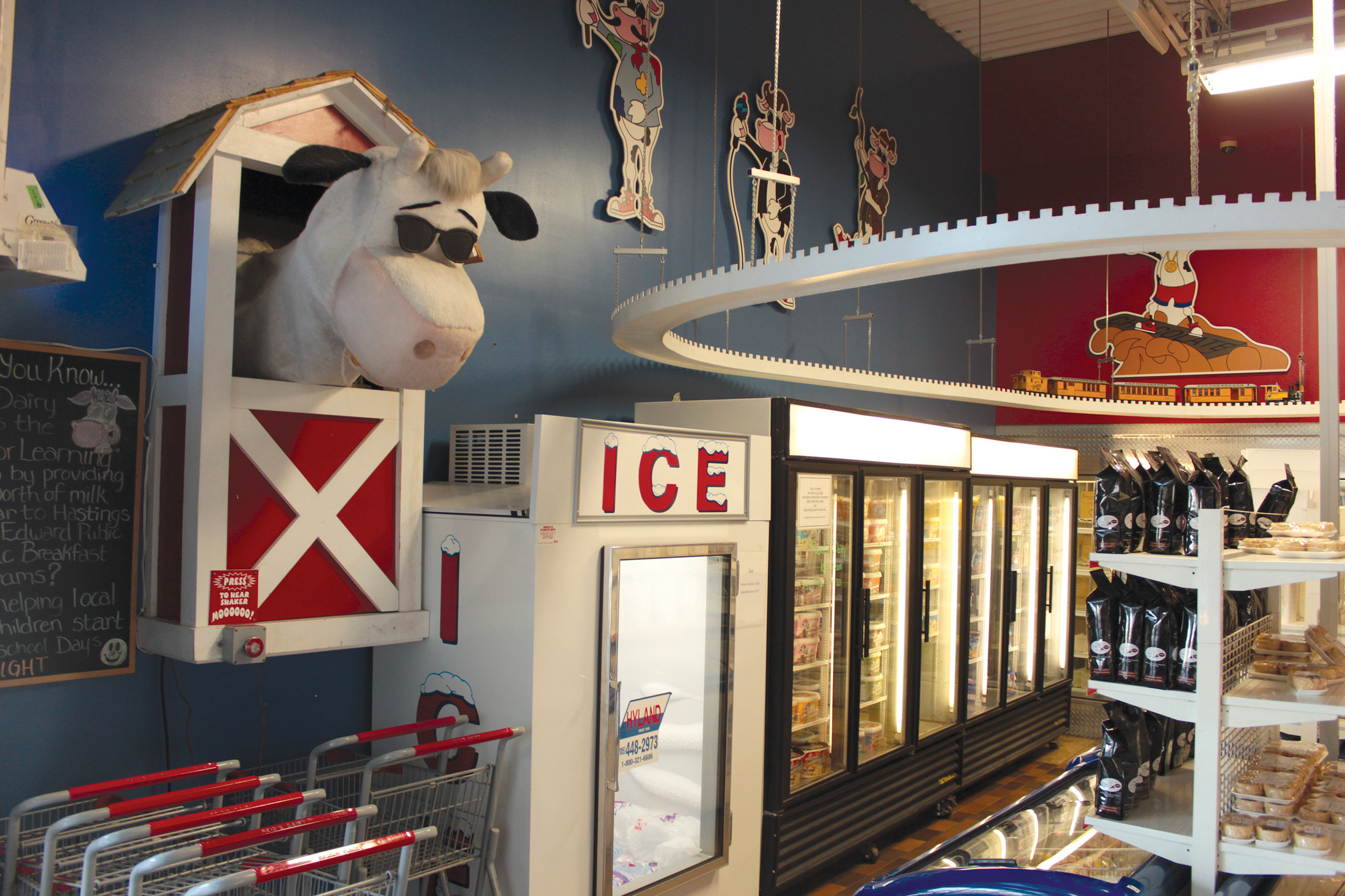 The Infamous Mooing Cow and Train track display at Reid's Dairy is always a hit with the kids and those young at heart. Photo by James Kerr.
