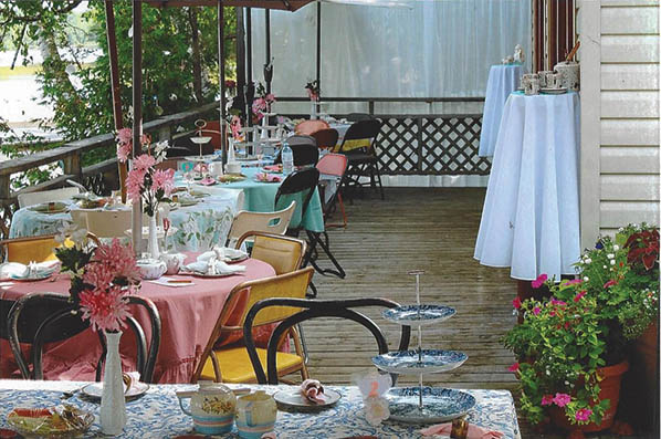 Judy and husband Tom set the stage for an inviting whimsical Tea Party. Photo courtesy of Beth Hennessey and Judy Tunnicliff