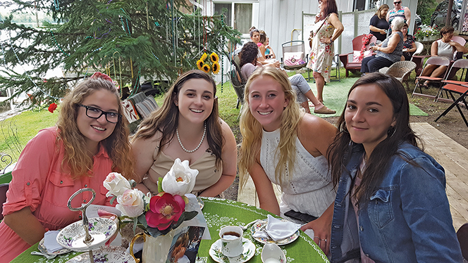 The Alumni Table: (left to right) Peyton McNevin, now 21, a guest for 20 years; Hannah Cowell, 10 years; Marly Danford, and Aida Peters. Photo courtesy Lorraine Gibson-Alcock
