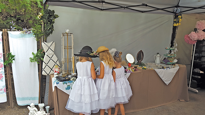 """""""3 Little Girls"""" eyeing the jewellery selection in the """"Shoppe"""". Photo courtesy Lorraine Gibson-Alcock"""