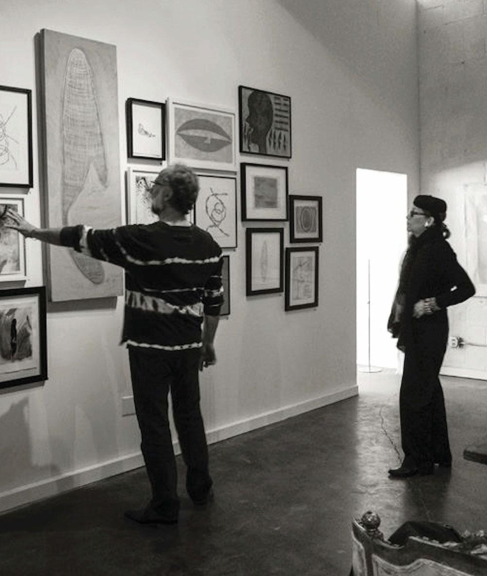 "Scott Heidmann with artist Shea Gordon Festoff at the May 2014 Heidmann Art Salon event ""Under The Influence,"" exhibiting works by Gordon Festoff PHOTO: Pilar Law"