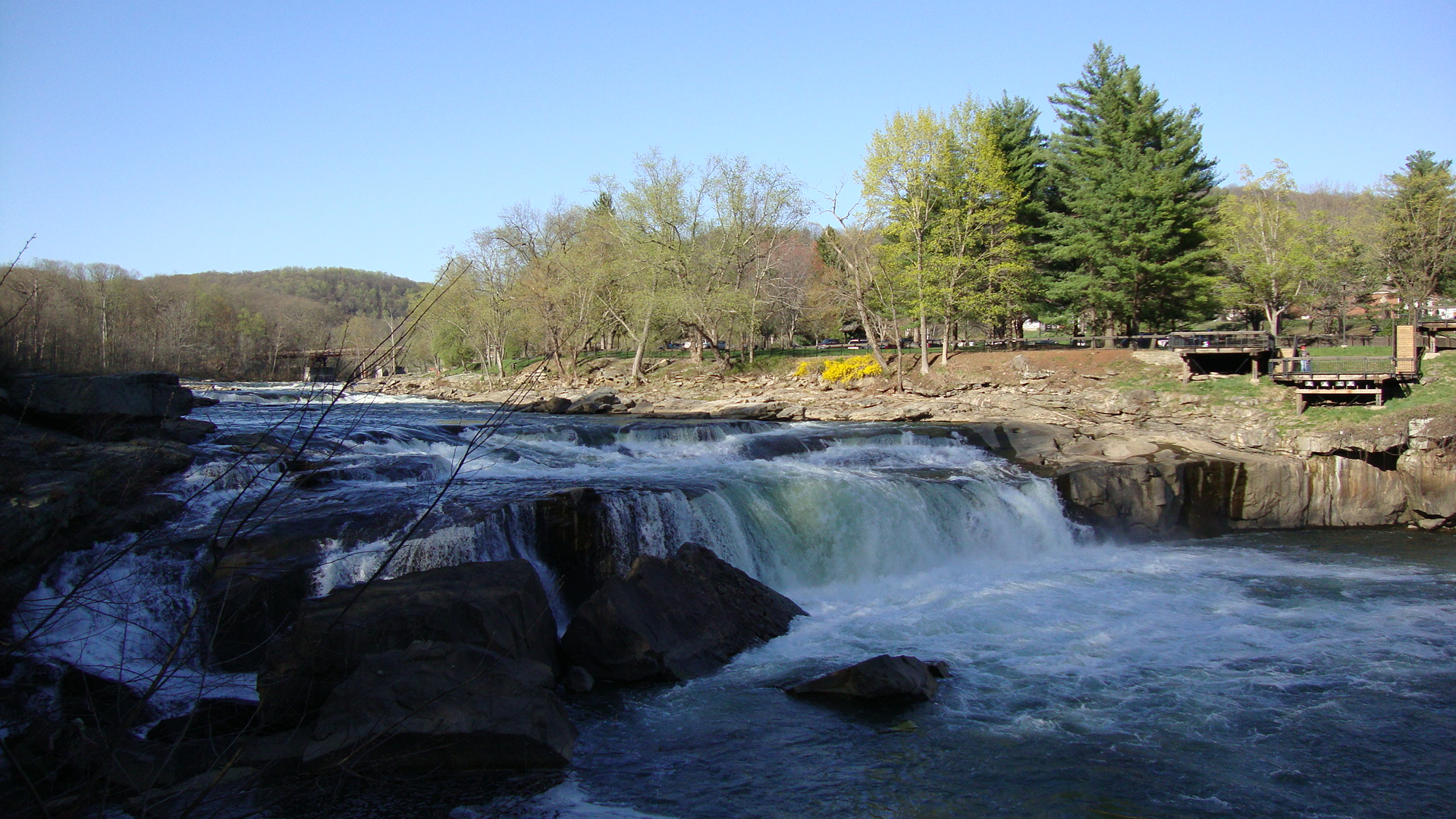 """One of Ohiopyle's falls, image courtesy of google images.    2. McConnells Mills State Park  This is another summer """"must do,"""" because of their gorgeous summer trails. Perfect for any hiker, these trails provide not only a great workout but also an amazing view. Spend a weekend away checking a glimpse of some of the best creations in nature."""
