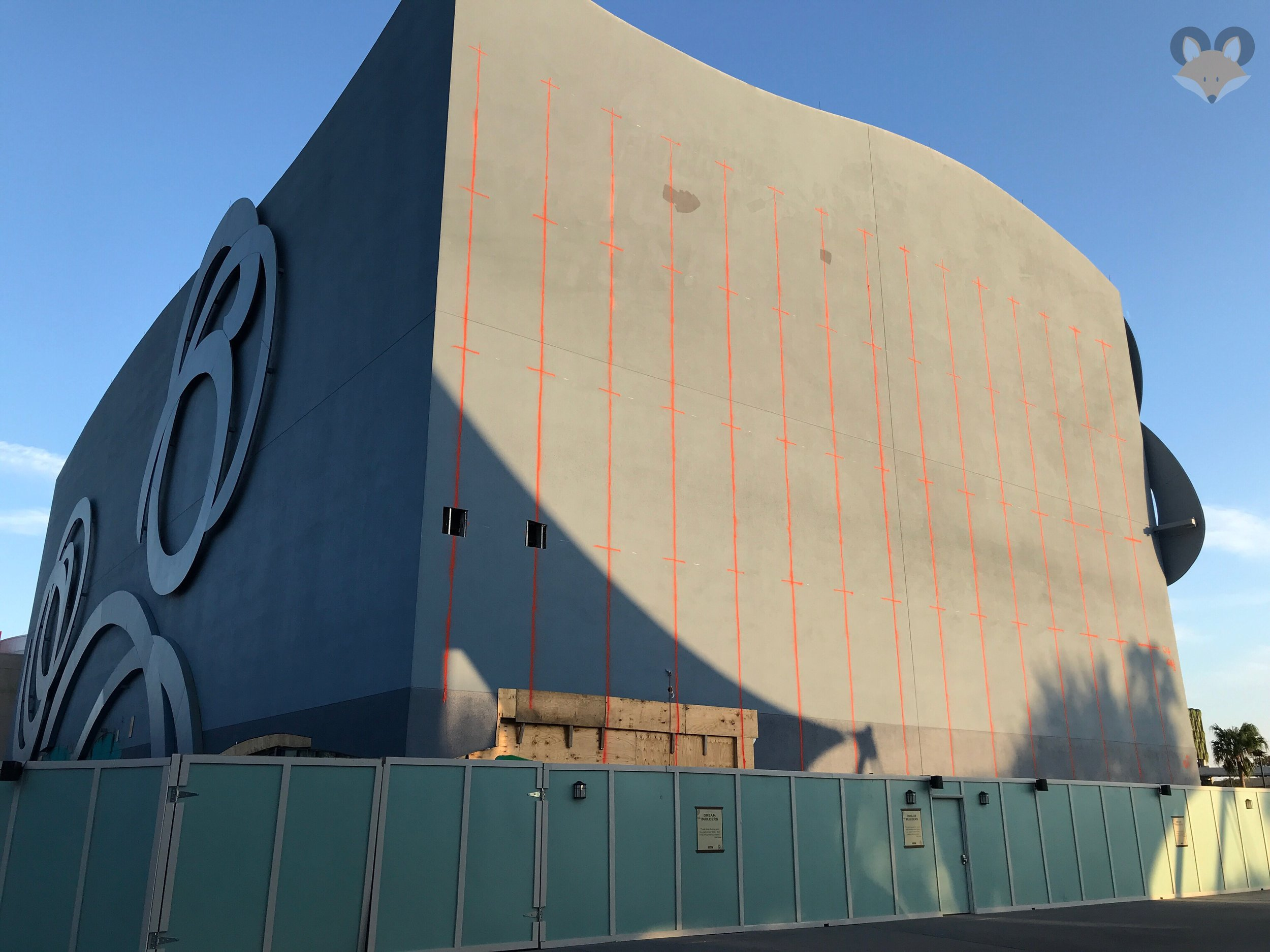 The side facing Cirque is prepped with orange spray paint to help the crews control the demolition.