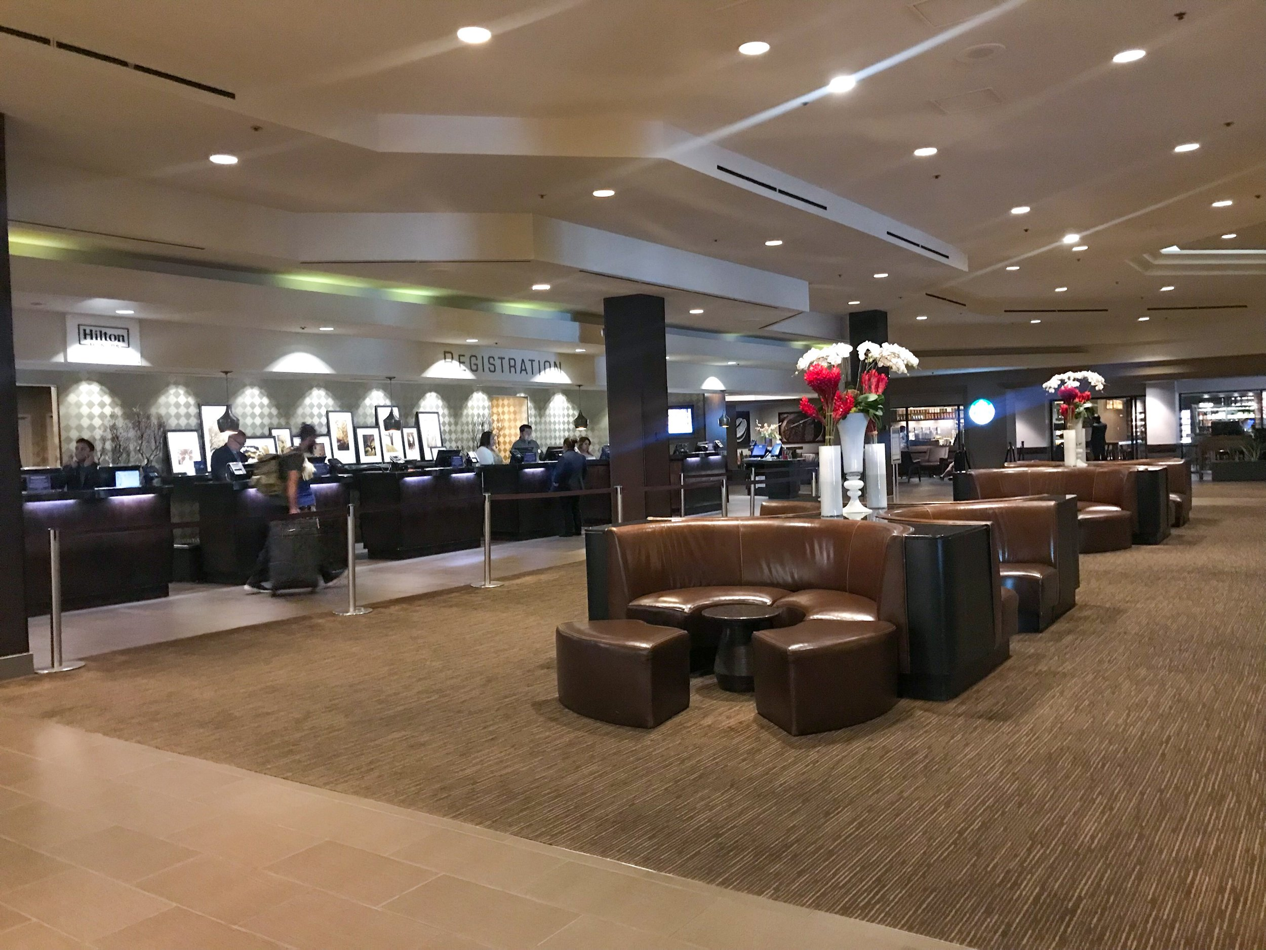 Open and spacious lobby with plenty of check-in stations at the registration desk.