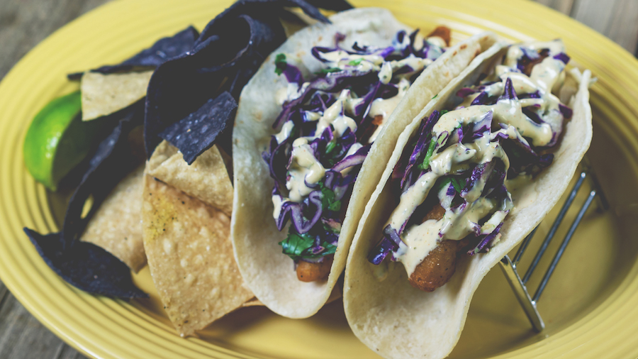 Purple Fish Tacos   Disneyland Park, Rancho del Zocalo  Baja-style fish tacos with purple cabbage slaw and spicy lime aïoli served with a side of blue corn chips