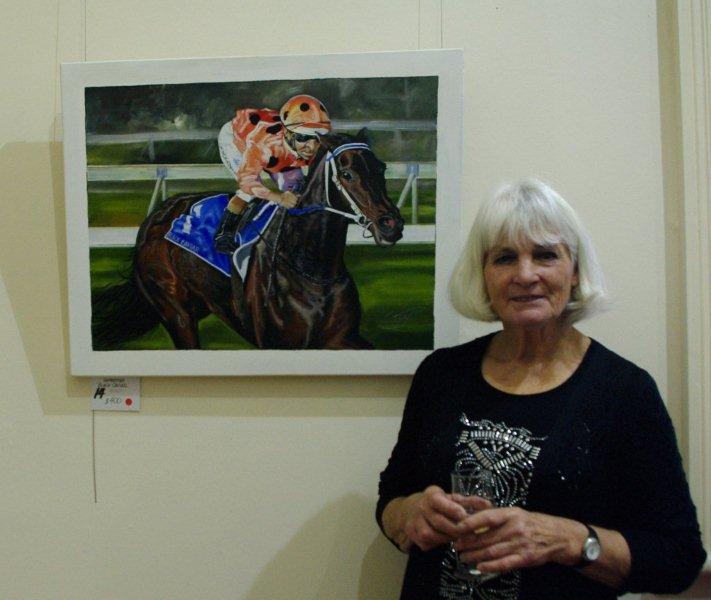 "Ellen Styne with her painting ""Black Cavier"""