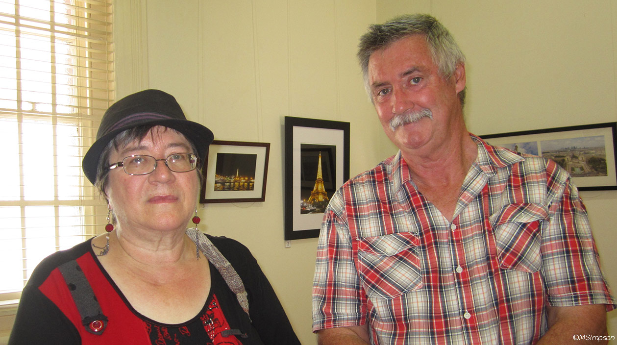 Gawler Community Gallery's PR Officer and exhibiting photographer Robert Laidlaw in front of some of Robert's works