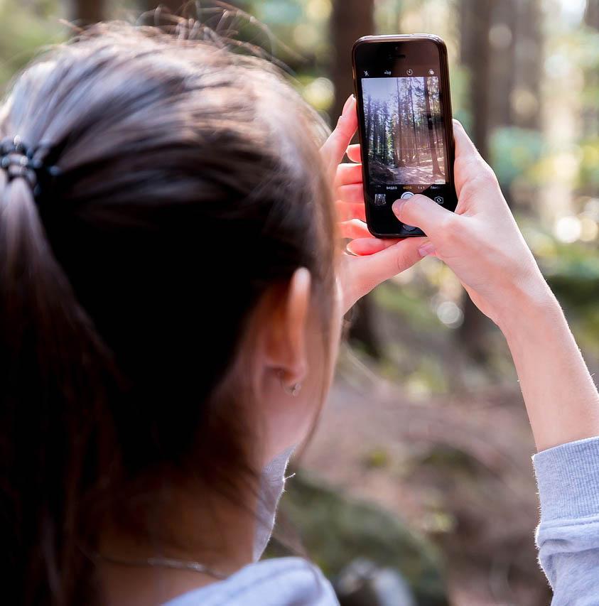 Woman using Phone Camera