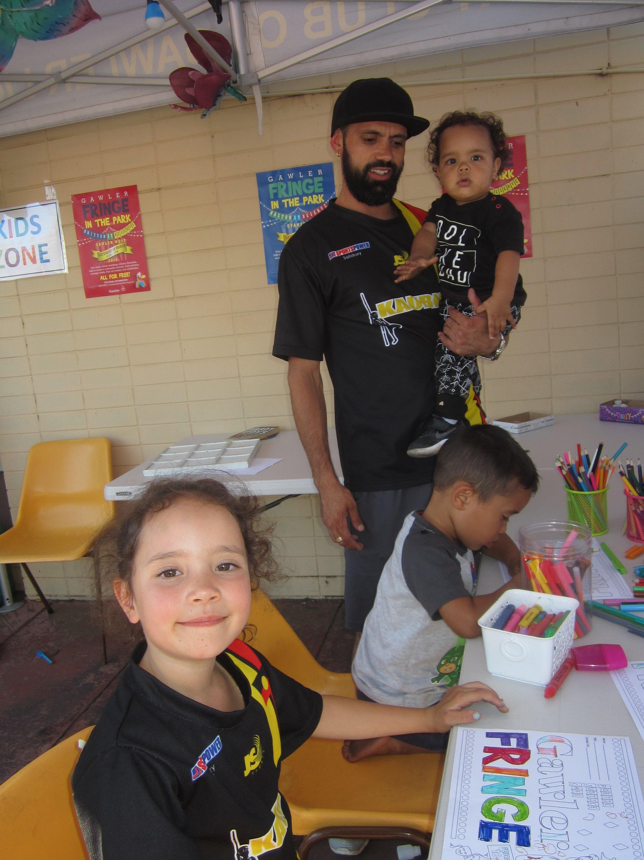Jack Buckskin with his children in the Kids Zone.