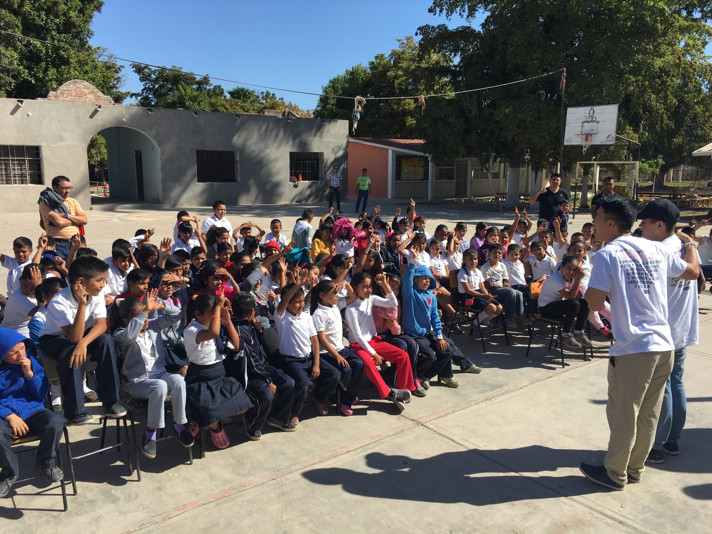 Preaching the gospel to an elementary school in Teroque