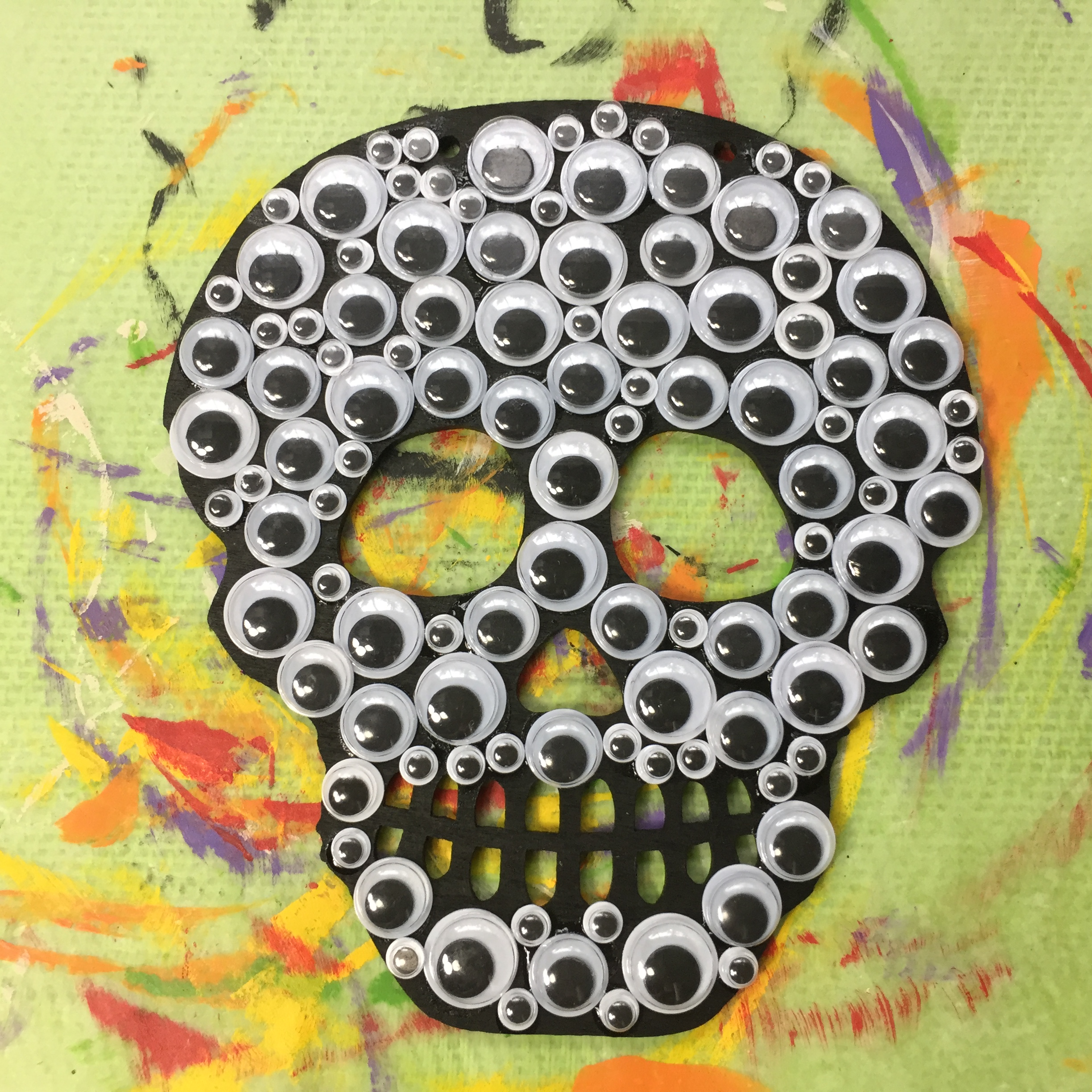 wood skull with googly eyes