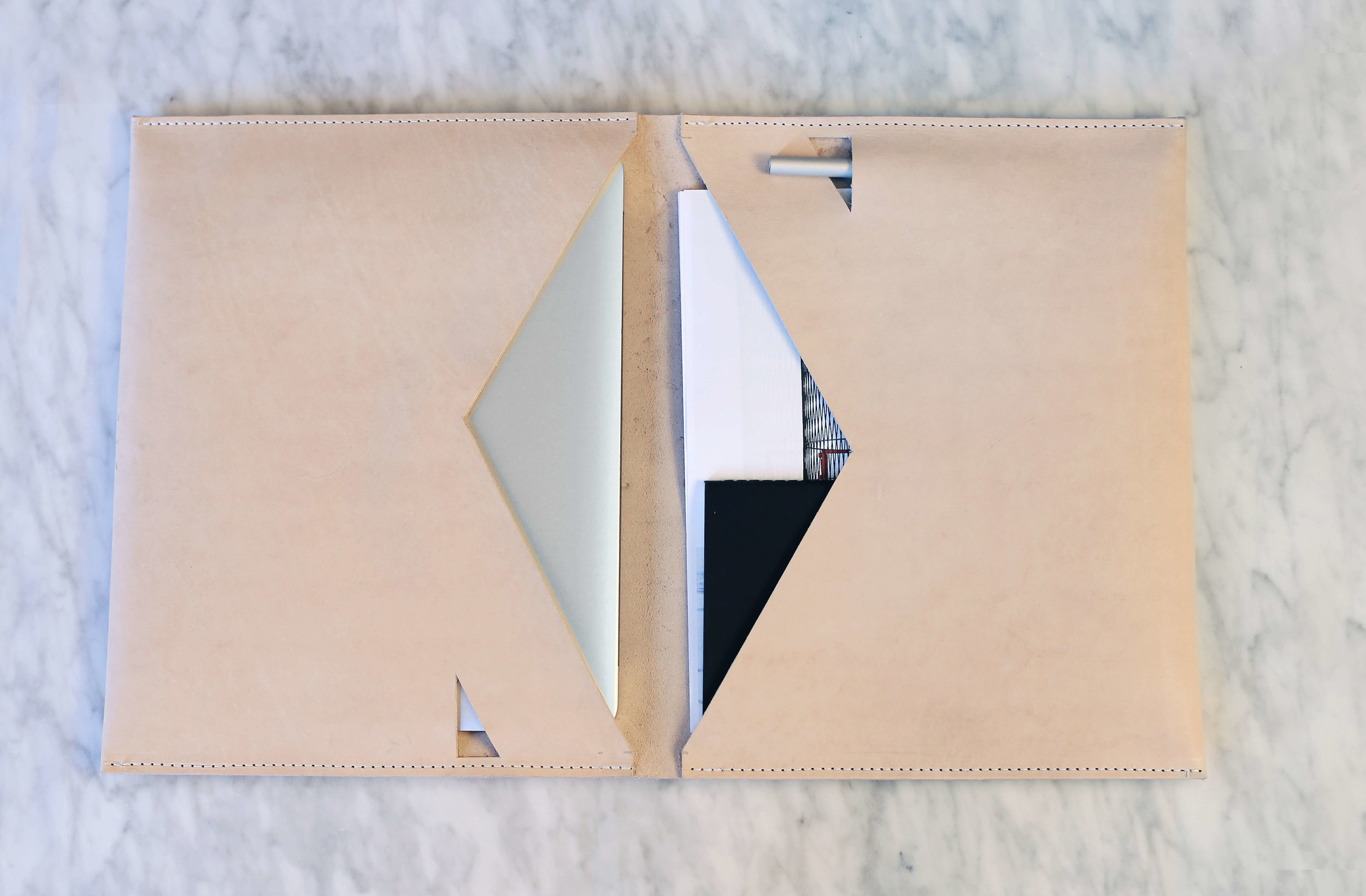 FORMAT - ADL partnered with LHOOQ to design leather iPad Pro portfolios. We designed the product in AutoCAD, worked with a local Shepard in hand making the folios and launched our line on Kickstarter.